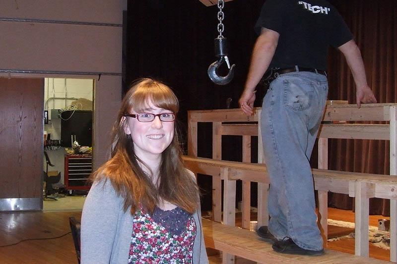 Student volunteers work in costume, prop and set design